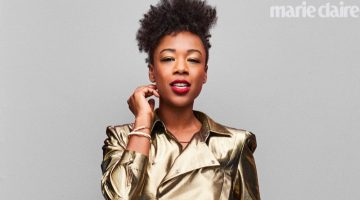 Shining in gold, Samira Wiley wears Saint Laurent top, belt and denim shorts