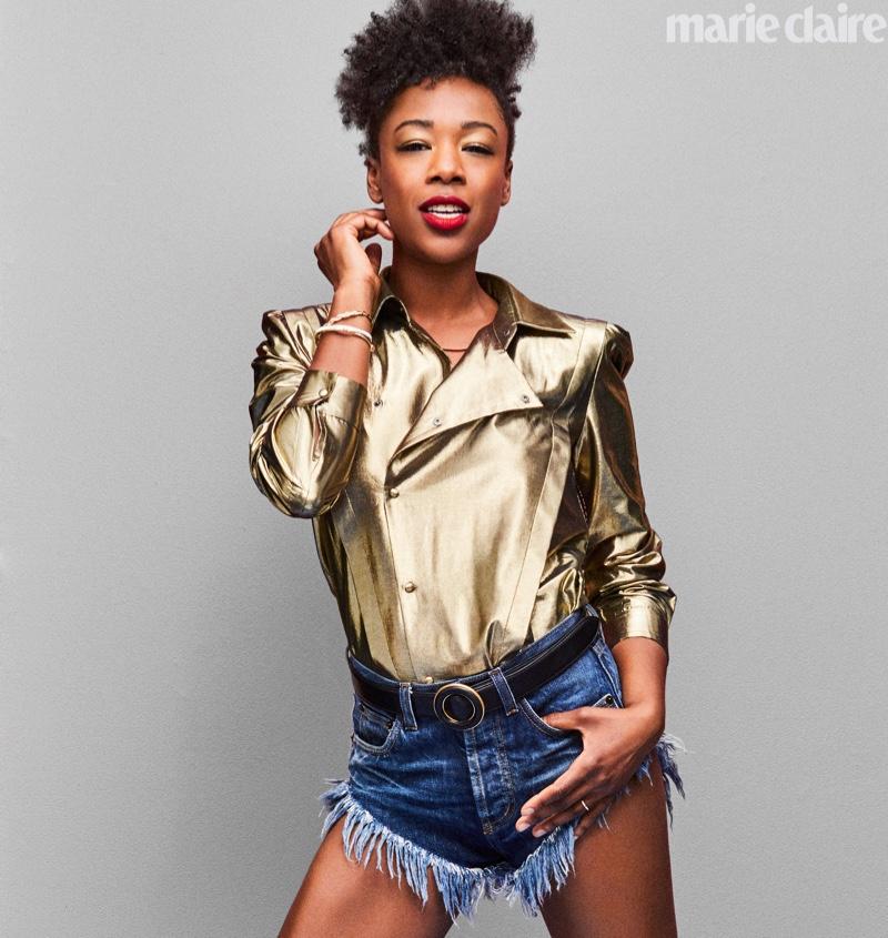 Shining in gold, Samira Wiley wears Saint Laurent top, belt and denim shorts