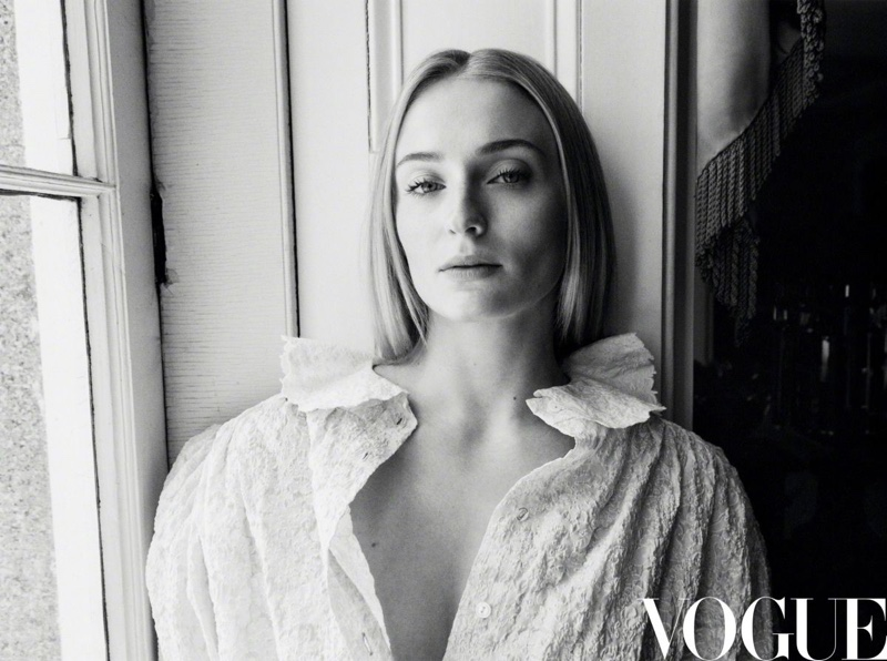 Actress Sophie Turner poses in white blouse