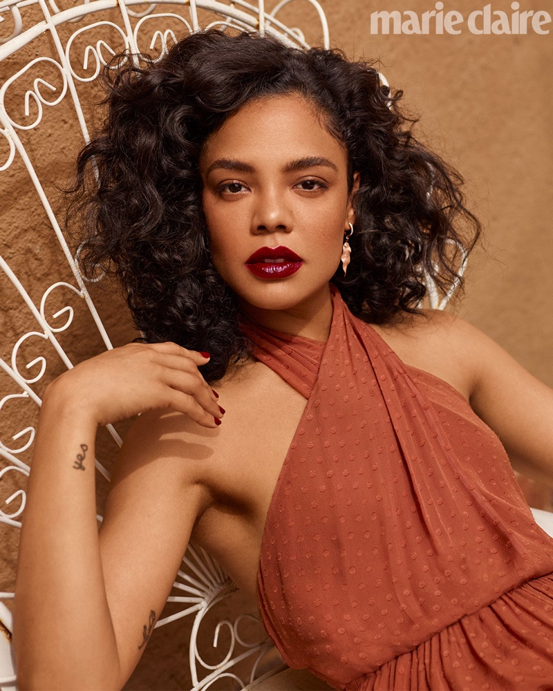 Tessa Thompson poses in Kate Spade New York dress and Simon G. Jewelry earrings