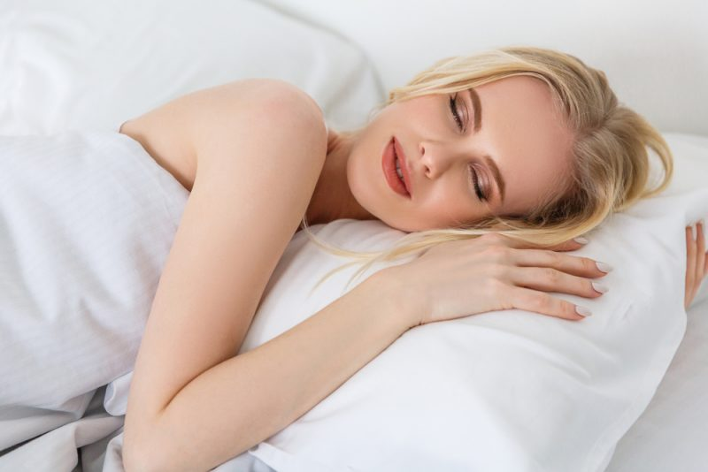 Woman Getting Beauty Rest Sleeping in Bed