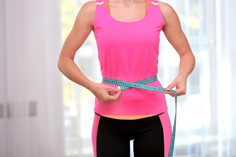 Woman Measuring Waist Pink Top Workout Clothes