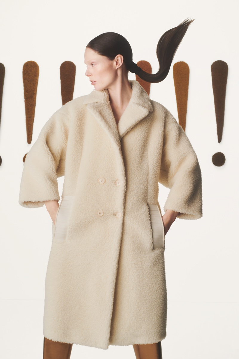 Model Coco Rocha wears chic outerwear for Akris fall-winter 2019 campaign