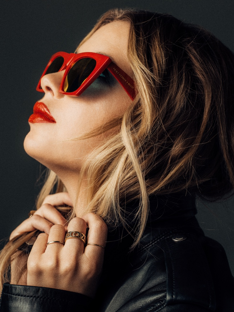 Posing in red shades, Ashley Benzo fronts Prive Revaux Benzo collection
