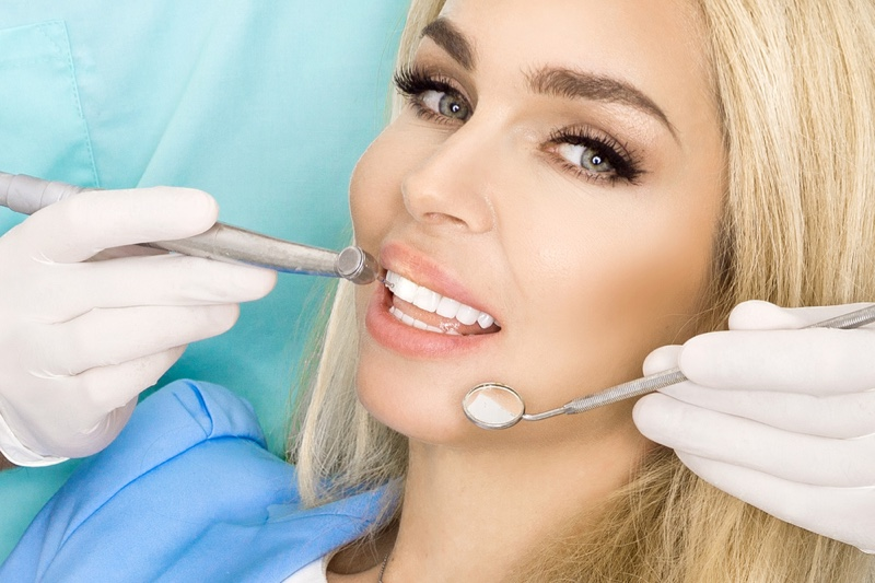 Blonde Woman Dentists White Teeth