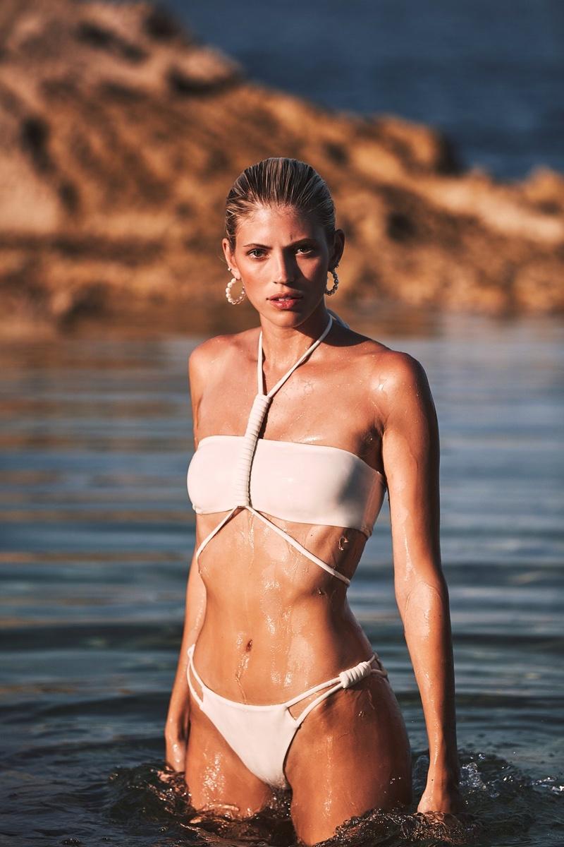 Model Devon Windsor poses in her namesake swimsuit line