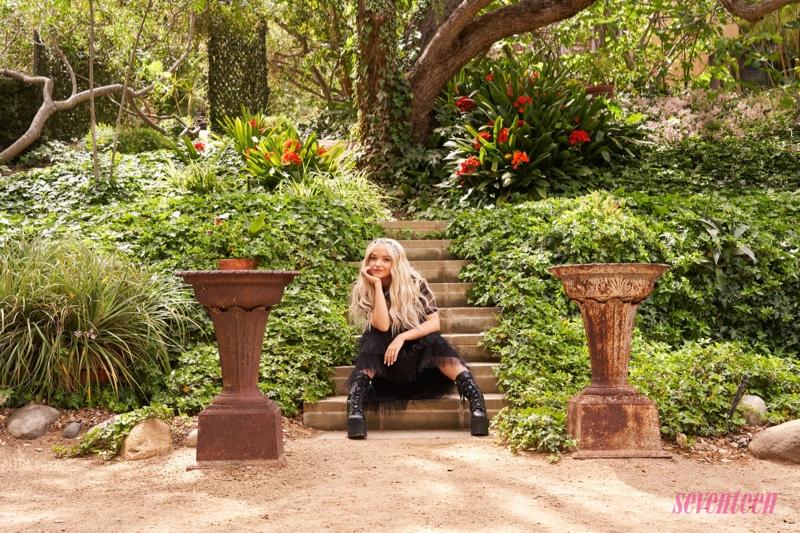 Dressed in black, Dove Cameron wears Dolls Kills boots
