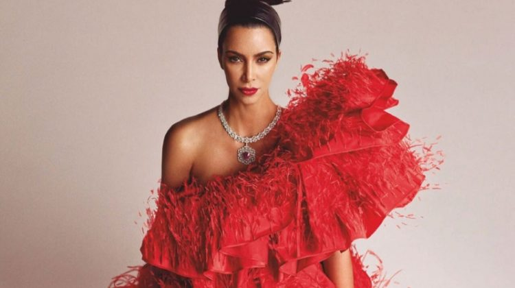 Dressed in red, Kim Kardashian wears Valentino Haute Couture gown