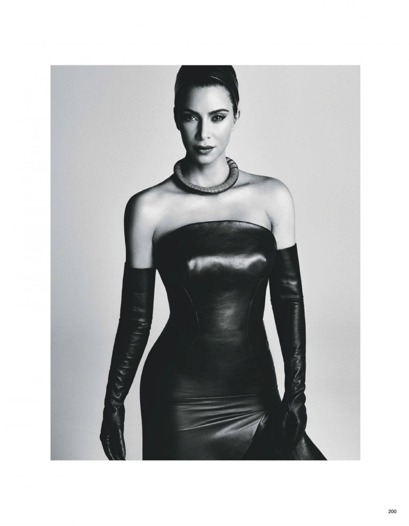 Caption Wearing a form-fitting look, Kim Kardashian poses in black and white