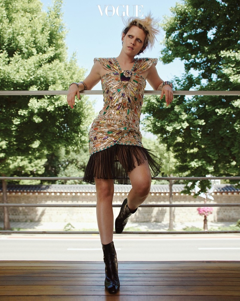 Actress Kristen Stewart poses in gold Chanel dress