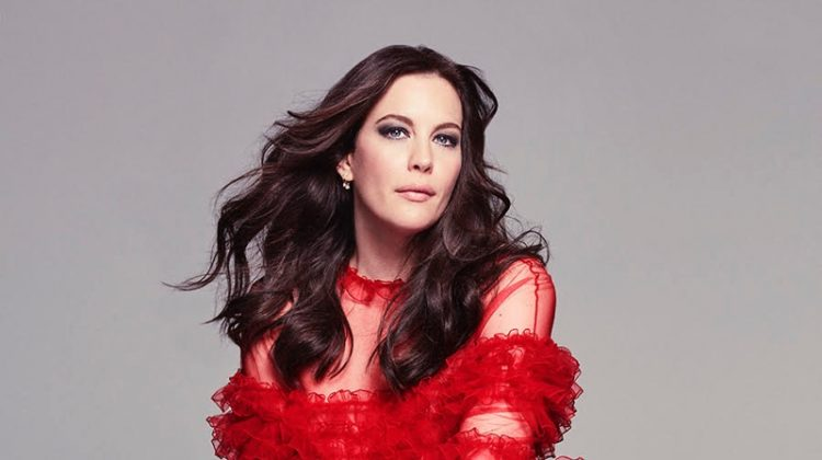 Dressed in red, Liv Tyler poses in Valentino gown