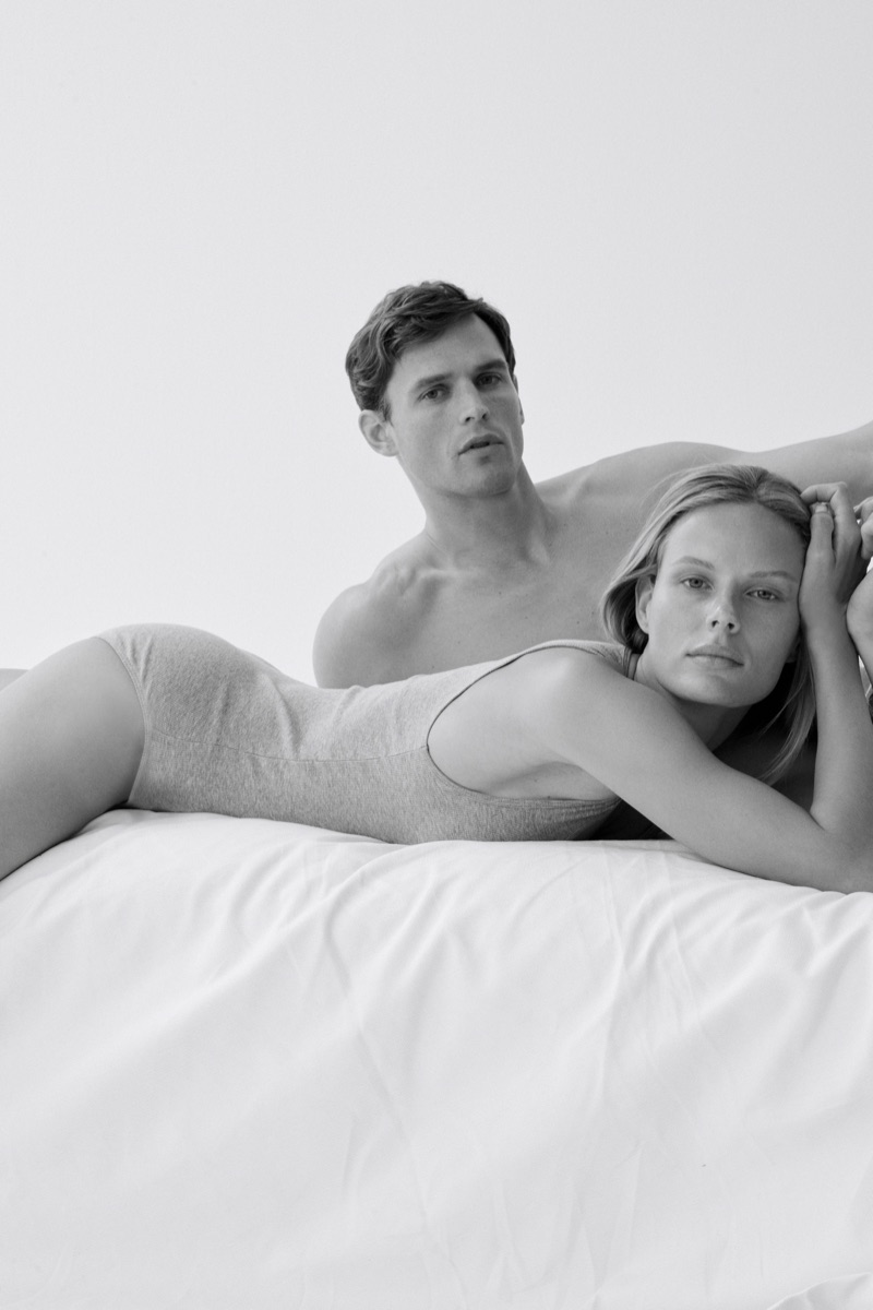 Posing in bed, Marlijn Hoek and Guy Robinson front Marc O'Polo Body + Beach 2019 campaign