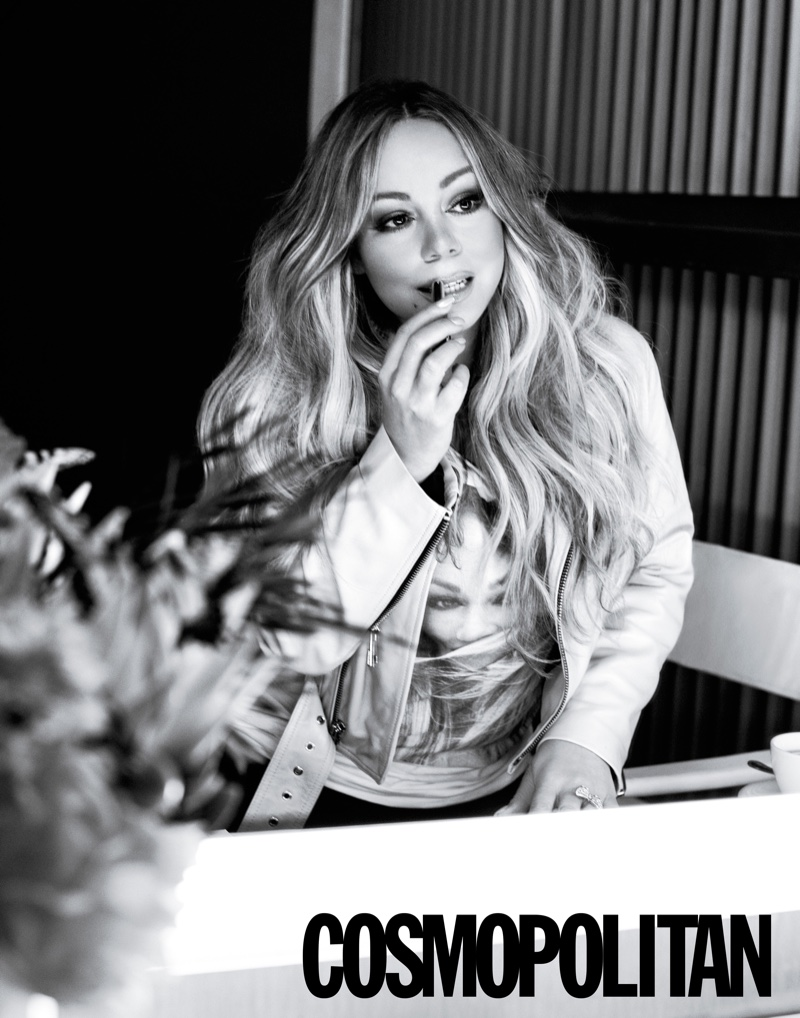 Primping for the mirror, Mariah Carey poses in Nour Hammour jacket, Mariah Carey Store T-shirt and Mother jeans