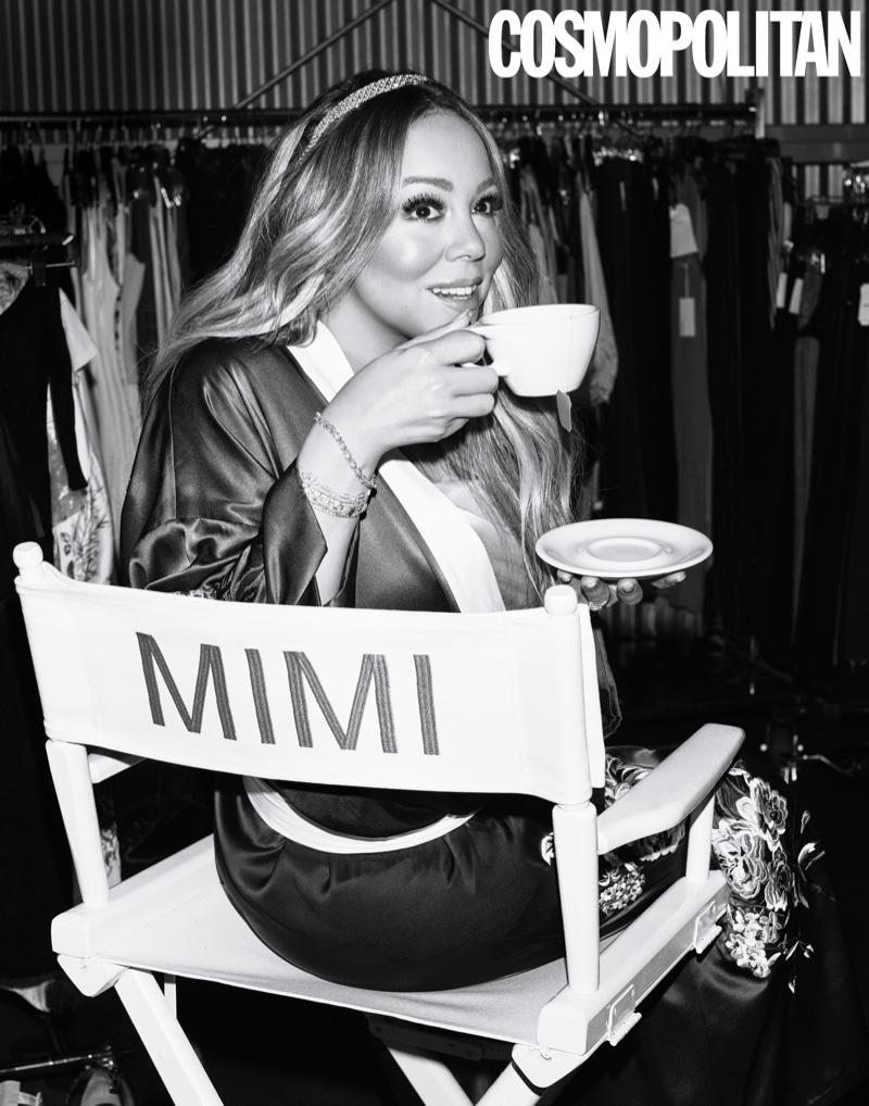Singer Mariah Carey poses in Olivia von Halle robe, Fleur du Mal dress and Munnu/The Gem Palace headband