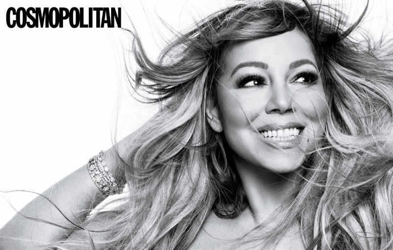 Ready for her closeup, Mariah Carey flashes a smile