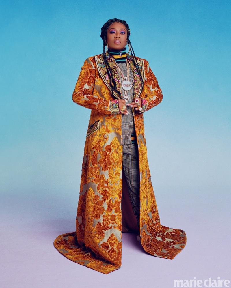 Rapper Missy Elliott poses in Dolce & Gabbana coat, jacket and pants