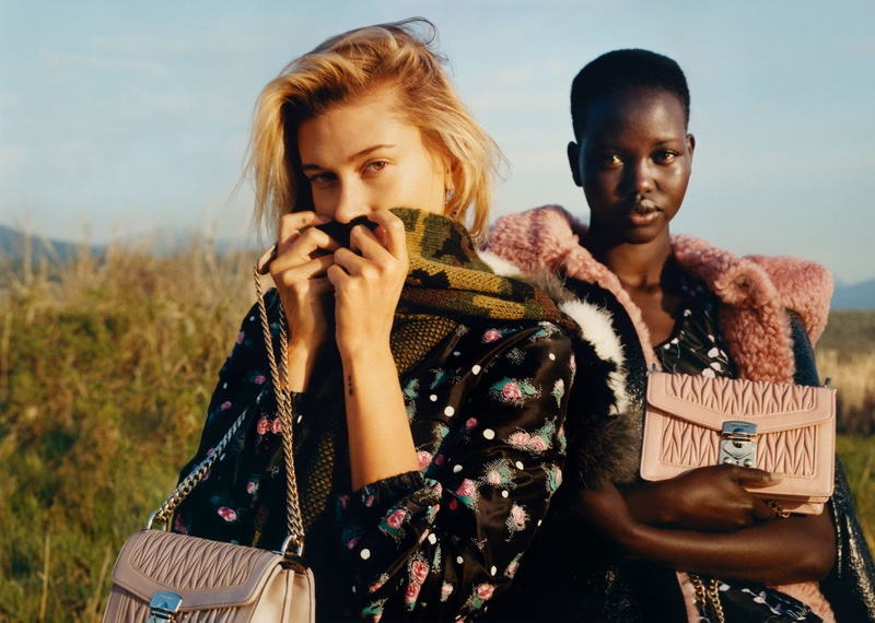 Models Hailey Baldwin and Adut Akech front Miu Miu fall-winter 2019 campaign