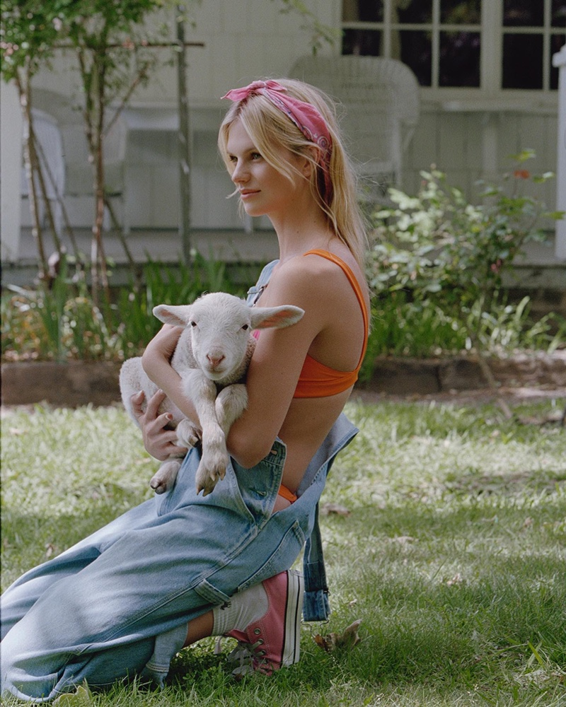 Posing with a goat, Nadine Leopold wears a look from Bamba Swim