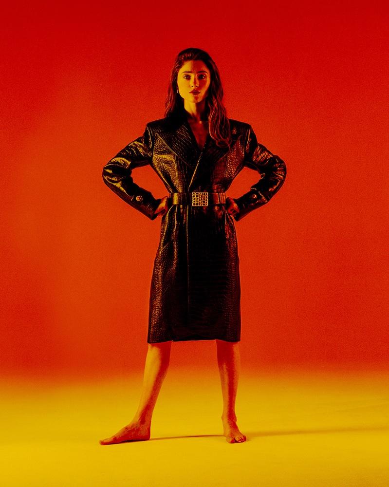 Actress Natalia Dyer wears Chanel coat and belt