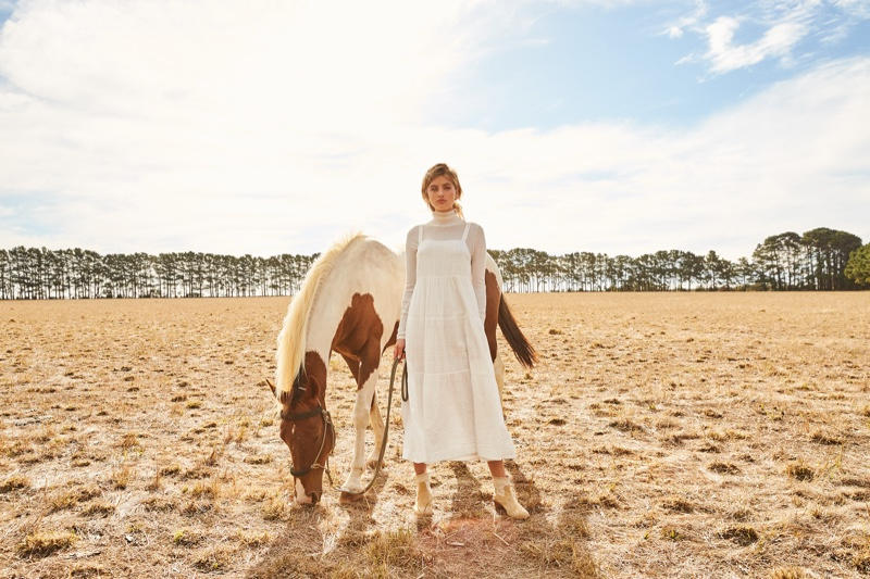 Posing with a horse, Megan Irwin appears in Rowie The Label pre-spring 2019 campaign