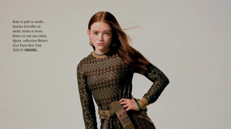 Striking a pose, Sadie Sink wears Chanel dress, sweater and boots