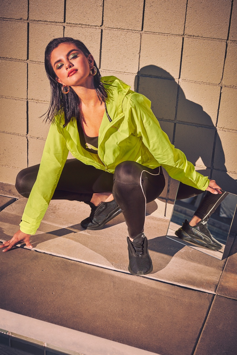 Wearing neon green, Selena Gomez shows off PUMA's new LQD CELL Shatter Luster sneaker