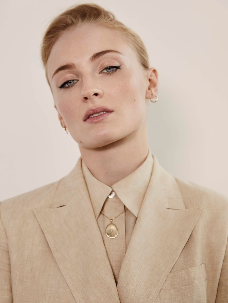 Actress Sophie Turner wears Theory blazer and shirt