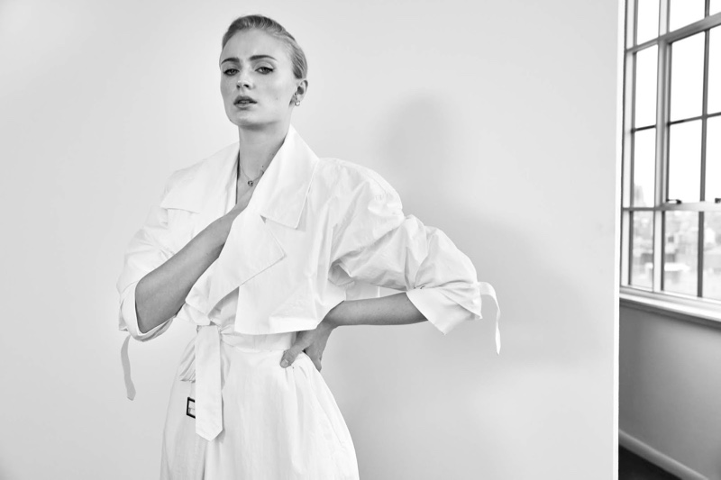 Captured in black and white, Sophie Turner wears Deveaux coat