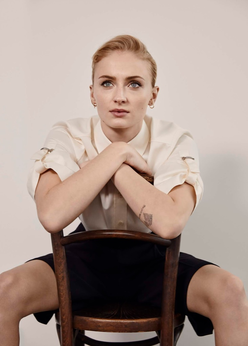 Sitting in a chair, Sophie Turner models Givenchy shirt and PushButton shorts