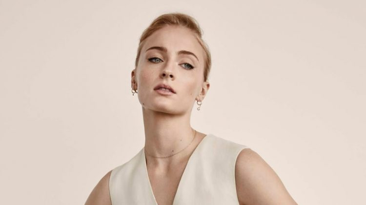 Striking a pose, Sophie turner wears Blazer, top and pants from Victoria, Victoria Beckham