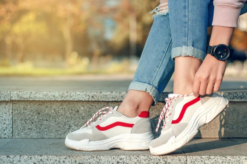 Woman Adjusting Sneakers Watch
