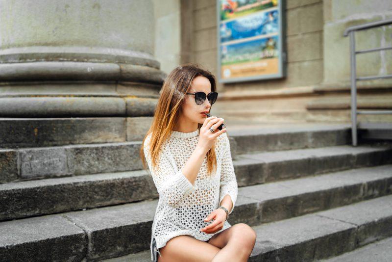 Woman Outside Vaping