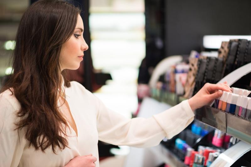Woman Shopping Cosmetics Store