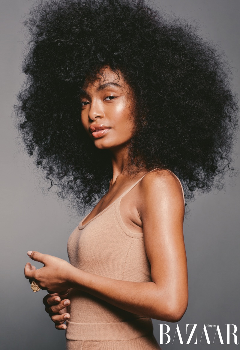 Yara Shahidi poses in Michael Kors Collection bodysuit and skirt with Cartier ring
