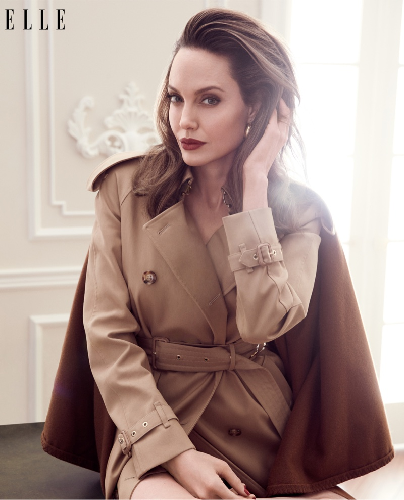 Angelina Jolie wears Burberry trench coat with Rosantica earrings