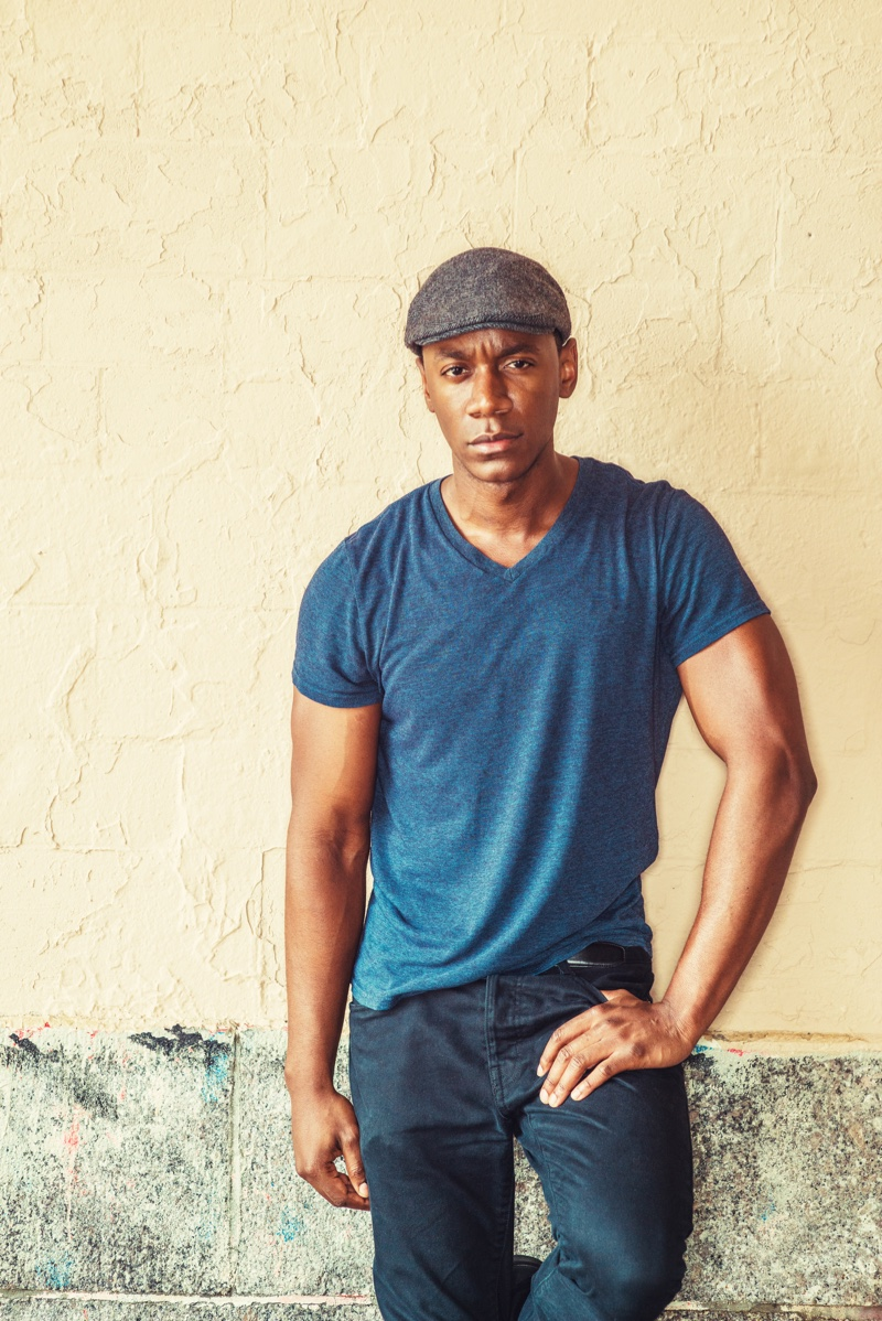 Black Man V-Neck Shirt Jeans Newspaper Boy Cap