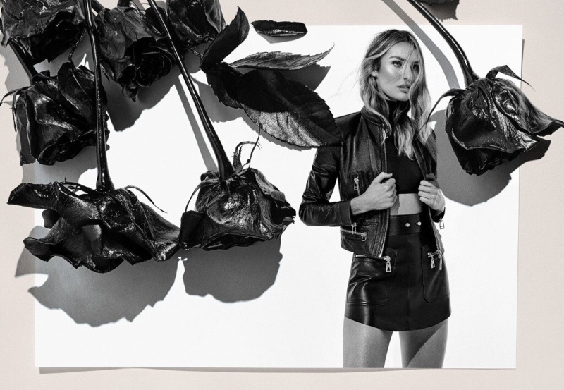 Model Candice Swanepoel poses with roses in Animale Espanha 2019 campaign