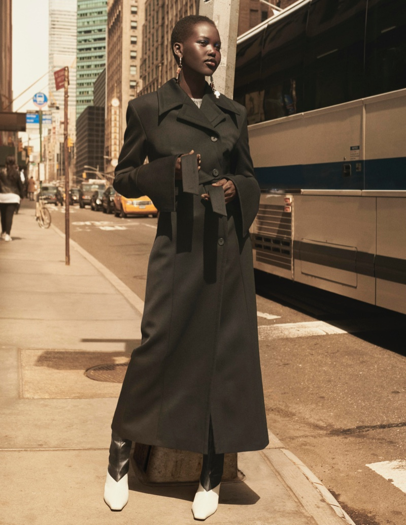 Adut Akech poses in belted coat for H&M Studio fall-winter 2019 campaign