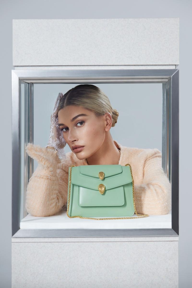 Model Hailey Baldwin poses with Serpenti Forever bag for Alexander Wang x Bulgari campaign