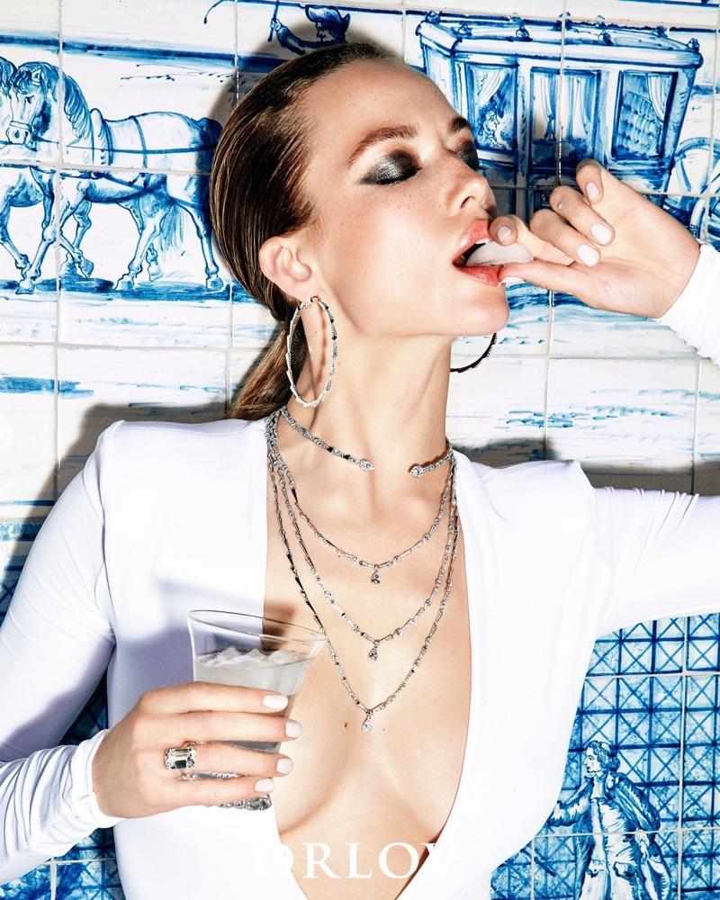 Model Hannah Ferguson wears designs from Orlov Croco Dream collection
