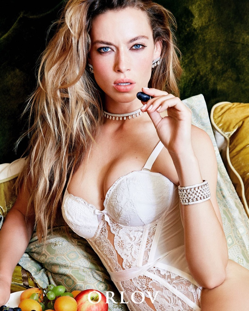 Dressed in lingerie, Hannah Ferguson models Orlov Simplicity collection