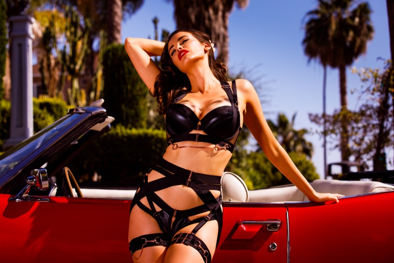 Posing next to a red convertible, Sarah Stephens fronts Honey Birdette Bodyguard campaign