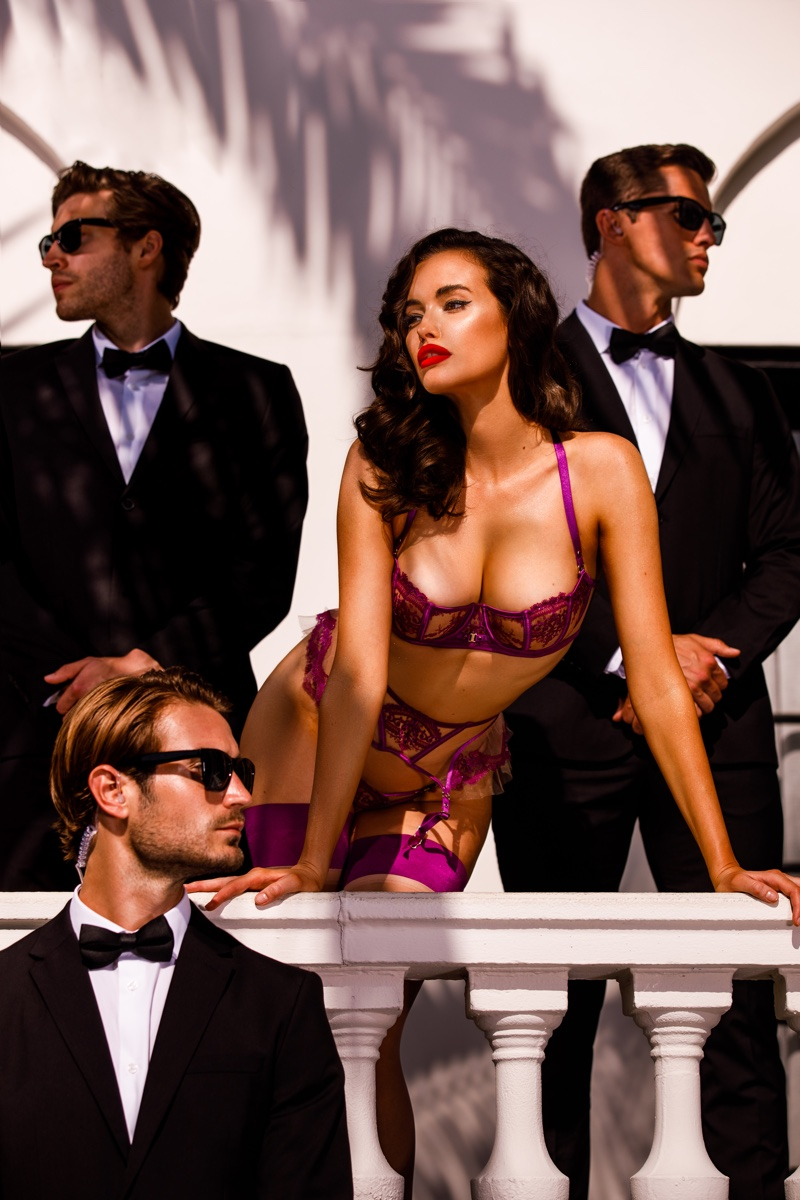 Surrounded by hunky men, Sarah Stephens appears in Honey Birdette Bodyguard campaign