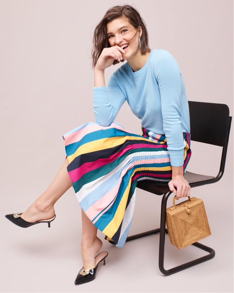 J. Crew Long-Sleeve Everyday Cashmere Crewneck Sweater $98, Smocked Skirt in Rainbow Stripe $148, Sophia Kitten Heels $178 and Bembien Stella Bag $185