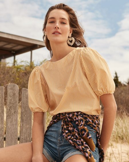 J. Crew Puff-Sleeve Top $69.50, Crewneck Sweater in Leopard $89.50, High-Rise Eco Denim Short $59.50 and Oversized Heart Earrings $39.50
