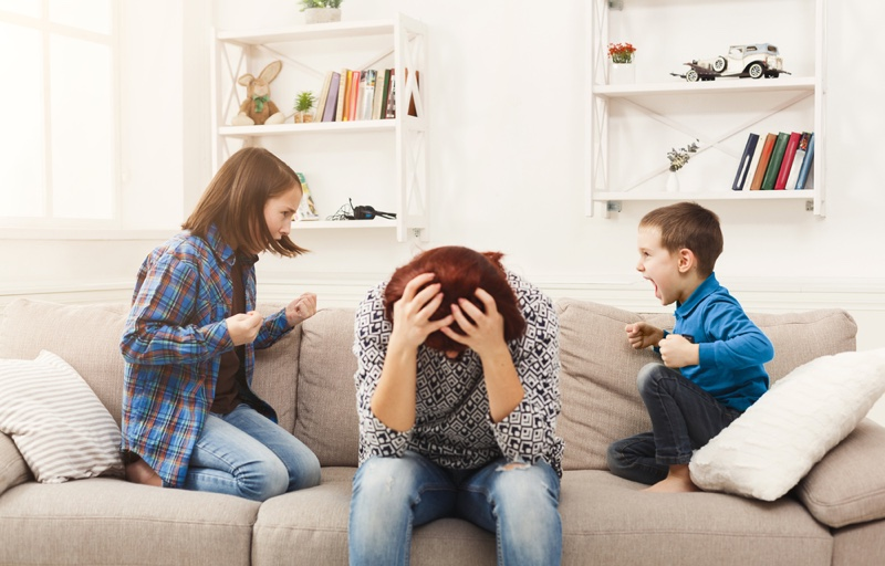 Mother Stressed Couch Fighting Kids Children
