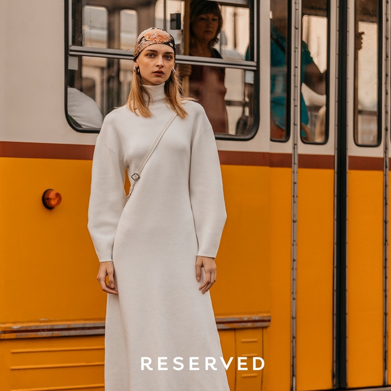 Model Daga Ziober poses in Reserved long-sleeve dress