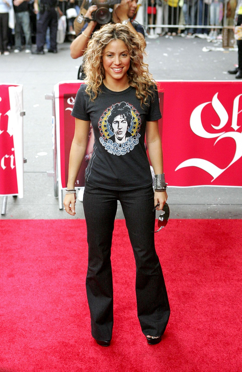 Shakira wearing Bruce Springsteen t-shirt and jeans.