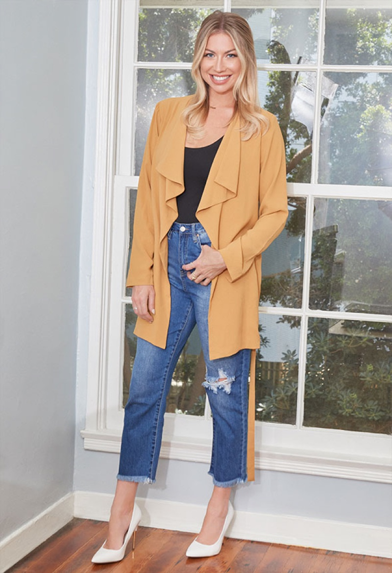 Vanderpump Rules star Stassi Schroeder wears drape front trench coat from JustFab collaboration