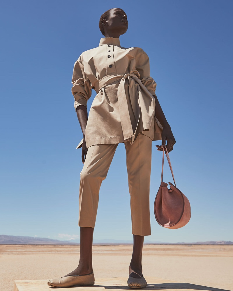 The Row Big Varo Tunic Shirt $2,050, Clark Cotton Slim-Leg Ankle Pants $1,020, Canvas Ballet Flats $640 and Suede Drawstring Pouch Bucket Bag $1,200